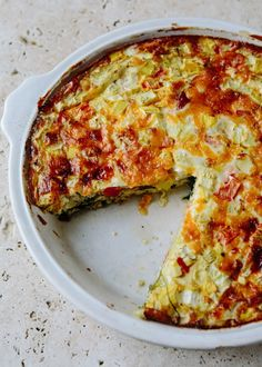 This quiche is all about the transformation of humble ingredients into a beautiful meal. Using butter, chopped vegetables, large eggs, milk and grated cheese, this quiche is the perfect example of a very vegetarian dish and a form of healthy comfort food.