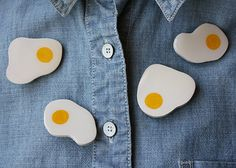 Breakfast is ready!    This listing is for an egg brooch with shape like the one on second picture.    Hand painted and unique.    Painted and resin glazed to protect it and make it look glossy!    Wood-like material and a metal brooch behind.    Size: 4 x 4 cm approx.    Packed with care ♥