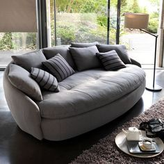 Superb Contemporary Sofa With Round Shapes And Soft Upholstery Fabric