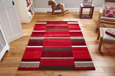 Striking Bold Red Blocks Design makes this Jazz Rug a stylish addition to your decor. #woolrugs #largerugs #redrugs #modernrugs #luxuryrugs
