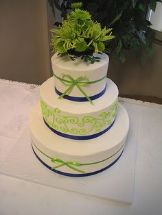 3 tier wedding lime green and royal blue ribbon. (Pink ribbon instead of blue and different flowers!)