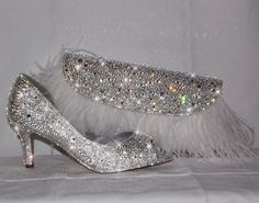 This dazzling clutch and flashy pumps are sure to make jaws drop! The sparkling duo contains more than 10,000 genuine Swarovski crystals!!! Buying these two together will save you $150! Custom orders always welcome!