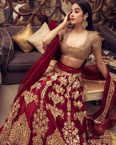 Janhvi Kapoor in a red and gold lehenga sets fashion at Isha Ambani, Anand Piramal's wedding - Clever Fashion Media Muslim Wedding Dresses, Indian Wedding Outfits, Bridal Outfits, Indian Outfits, Indian Clothes, Wedding Lenghas, Lehenga Wedding, Desi Clothes, Bridesmaid Dresses