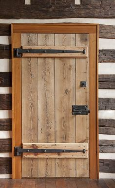 hardware for the main door is made locally. The door latch, with its simple exposed latching mechanism, sets the entry apart.The hardware for the main door is made locally. The door latch, with its simple exposed latching mechanism, sets the entry apart. Rustic Doors, Wooden Doors, Rustic Interior Doors, Cabin Doors, Virginia Homes, Log Cabin Homes, Log Cabins, Old Doors, Front Doors