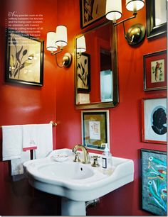 Elkins Double Sconces by Thomas O'Brien for Visual Comfort as featured in Lonny Magazine. Perfectly eclectic. Towel bar with multiple towels, sconces, gallery wall and bold color in small space.
