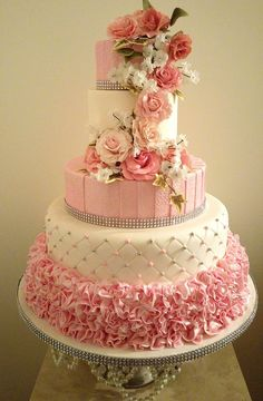 Ruffles And Roses Ruffles And Roses This a recent wedding cake I made. It has lots of ruffles and sugar roses filler flowers and ivy. https://www.facebook.... #valentine #valentines-day #heart #cakecentral