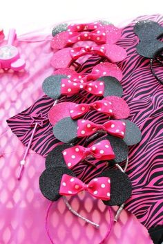 They were so fun and adorable! I bought a 12 pack of colored plastic bands from Dollar Tree ($core!). Bought a few spools of matching ribbon... Wrapped the bands and hot glued the ends.. Cut circles out of glitter Foam sheets (Michaels) Fold a little piece of the circle under the band and hot glue Made the pink polka dot bows out of ribbon and hot glued them on.