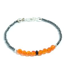 Pulsera de ágata naranja facetada de 5 milímetros y hematite facetado de 2 milímetros, con bolas y cierre en Plata de Ley 925.