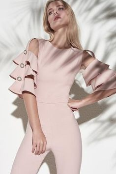 Blush jumpsuit with three layers of ruffles on the sleeves, pearl decorative buttons on the sleeves and nude mesh on the shoulder. Chic Outfits, Fall Outfits, Fashion Outfits, Womens Fashion, Sleeves Designs For Dresses, Fashion Details, Fashion Design, African Fashion Dresses, Fashion 2020