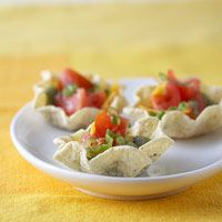 Mini Nacho Cups - Baked tortilla chips and reduced-fat cheddar cheese help keep these Tex-Mex morsels diabetic-friendly.
