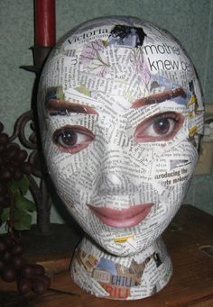 LOL!!!! Decoupaged Styrofoam Mannequin Head..I like it :) So interesting to add photo features.