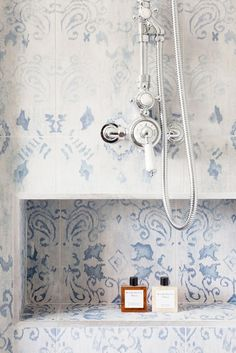 Patterned blue and white tile in shower