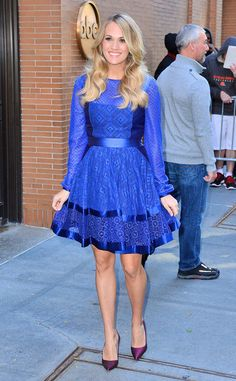 A pregnant Carrie Underwood beams in a chic royal blue dress!