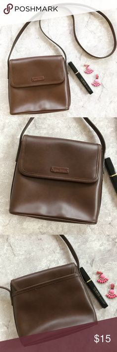 Nine West Brown Crossbody Bag Brown crossbody bag by Nine West. A non flashy mini purse for carrying the essentials! Plenty of room for your phone, charger, little notebook, and chapstick. • Excellent condition  • Flap Button closure • One inside Zip pocket, one outside open pocket • All man made materials Nine West Bags Crossbody Bags