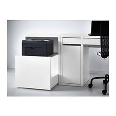 For printer storage to the left of the desk under A/C with mini bar on top