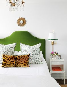 A velvet, leopard print lumbar pillow pops against the emerald green headboard and white, waffle-knit sheet. Pretty Bedroom, Bedroom Green, One Bedroom, Cheetah Bedroom Decor, Narrow Bedroom, Blue Bedrooms, Dream Bedroom, Bedroom Ideas, Green Headboard