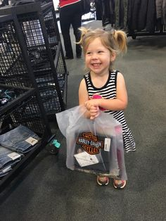 Ellie shopping for Papaw at the Harley store.