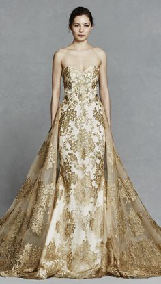 What a statement! GWENDELYN by Kelly Faetanini, a showstopping gold embroidery strapless fit to flare with illusion back neckline and detachable #gold embroidered skirt. @kellyfaetanini #KellyFaetanini #wedding #bridal #ad #weddingdress #weddinggown #romantic #lace