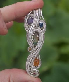 Raindance // chakra joose// tendai designs handmade wire wrapped jewelry/ heady pendant // grateful dead fare thee well // gift by TendaiDesigns on Etsy https://www.etsy.com/listing/236070628/raindance-chakra-joose-tendai-designs