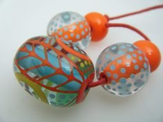 Moogin Beads- Oval focal bead set abstract coral with blue core- Lampwork / glass - SRA by mooginmindy on Etsy