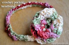 Crochet Baby Headband {Free Crochet Pattern}  I did it with multi colored yarn like pictured which made the flower a little difficult, but turned out cute.  I hope she likes it!