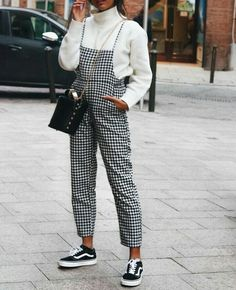 Gingham dungaree with white sweater and black vans. Casual on trend street style.