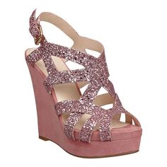 "Glitter sandal with covered  4 3/4""platform and 1 1/4"" wedge.  Adjustable buckle closure."