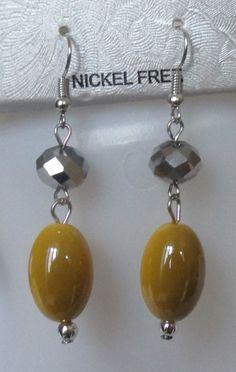 Boucles d oreilles pendantes perles jaunes bicolores et à argentées à facettes