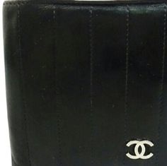 Vertical Quilted Unisex Men's  BG-#3955540 Gently used men's wallet. Some visible wear on the leather outside and inside. See photos. CHANEL Bags Wallets