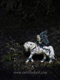a Schleich fairie figure, some wilderness, a digital camera and Photoshop