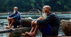Two Men Sitting on Riverbank · Free Stock Photo