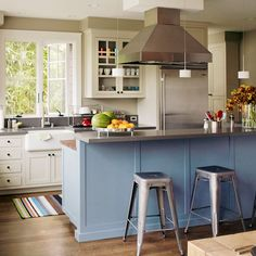 #15 Mix and Match  Mix and Match    A colorful island adds personality to an otherwise traditional white kitchen. The blue island in this kitchen coordinates with the cool gray countertops and stainless-steel accents.