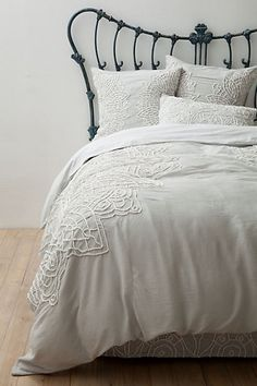 Inspired to try a DIY version of this Anthro duvet using sheets and vintage doilies.
