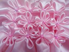 8 petal flower smocking pattern on a fabric                                                                                                                                                                                 More