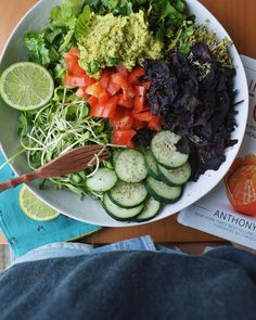 This salad is 2 heads of organic romaine lettuce, 2 cups sunflower sprouts, 1 cup each of homemade broccoli and clover sprouts, lots of dulse and cilantro, diced tomato, cucumber, onion and celery, topped with mashed avocado, lime juice and black pepper.