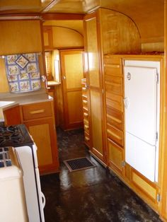 The kitchen area of a trailer camper rv caravan.  I like the vintage look of this, but it won't quite work for our silver twinkie (aka, Airstream)--too much wood.