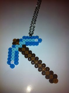 Minecraft Pickaxe Necklace. $9.00, via Etsy.