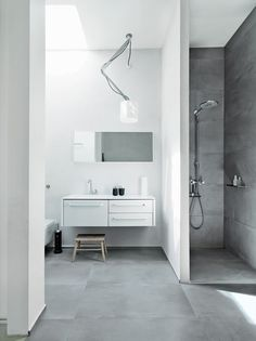 White and grey modern bathroom with open shower.