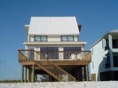 Gulf Shores, AL: This spacious 5-bedroom, 5-bathroom home, located directly on the beach, sits nestled on the white sandy beaches of Gulf Shores. Guylande Pass is loca...