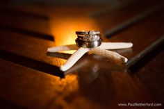 Wedding rings with sea star on Isla Mujeres, Mexico a destination Wedding near Cancun by Paul Retherford Wedding Photography, http://www.paulretherford.com