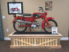 1966 Honda S65 motorcycle on display in my basement. Stand is made from pallets
