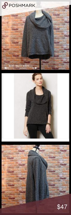 """Anthropologie Angel of the North Cowlneck Sweater Anthropologie Angel of the North boucle cowl neck sweater in a size large.  Has kangaroo pocket in the front with velvety lining.  Back has large pleat down the middle.  Long sleeves.  Hi Low length.  Measures 22"""" armpit to armpit and 20 1/2"""" in length in the front and 24"""" in length in the back.  40% wool, 40% acrylic, and 20% polyester.  In excellent condition. Anthropologie Sweaters Cowl & Turtlenecks"""