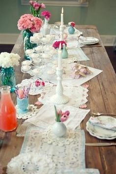 Shabby chic dining room table. layers of lace and white linen for the table runner.