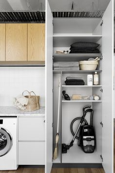 laundry room utility cupboard for broom, vacuum and cleaning products.