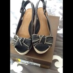 Franco Sarto black wedge sandals with bow Adorable black with cream trim wedge sandals with bow on front. In good condition. Franco Sarto Shoes Espadrilles