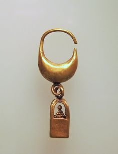 Earring, boat-shaped with cage and ball pendant Culture: Cypriot Medium: Gold Dimensions: Other: 1/2 x 1/4 x 1 1/2 in. (1.3 x 0.7 x 3.8 cm) Classification: Gold and Silver Culture: ...