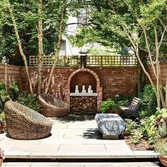 After: Terrace: Architectural Digest -New Eco Landscapes designed the backyard's bluestone-paved terrace; the matching lounge chairs are by West Elm.