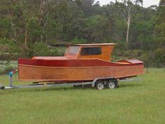 23ft dayboat launch - easy build in plywood 10hp high thrust outboard - light enough to trailer easily