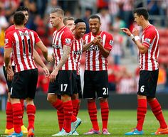 Southampton players come together at the final whistle to celebrate another win as they re...