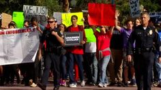 Fist pumping and signs waving, a protest of nearly 200 people traveled through Balboa Park before spilling onto downtown city streets Saturday afternoon.
